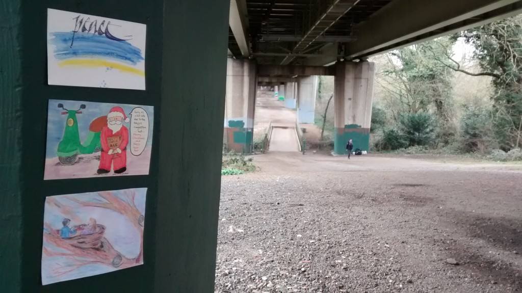 3 postcards on a wall under Brentford Bridge, where the TV series Misfits was filmed
